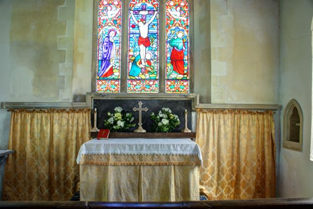 Altar and stained glass window